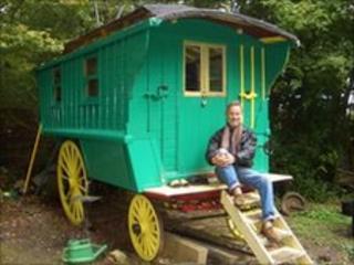 David Swanson sitting on his caravan