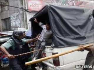 Police arrest an activist during a strike by the Bangladesh Nationalist Party (BNP) in Dhaka on 27 June 2010