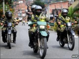 Soldiers on patrol in Medellin on 19 June 2010
