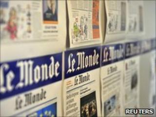 Pages of the day's last edition in the Le Monde office in Paris on 25 June 2010