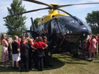 Pupils in Colwyn Bay examine the police helicopter