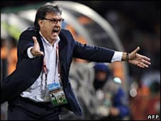 Gerardo Martino raced to embrace his players after they won the penalty shoot out
