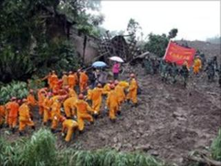 Rescue workers at the landslide site in Dazhai on 29 June 2010