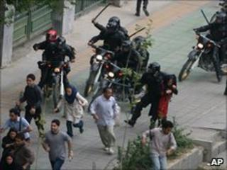 Iranian riot-police clash with protesters during riots in Tehran, June 2009