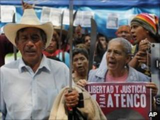 Demonstrators with placards and machetes outside the Mexican supreme court