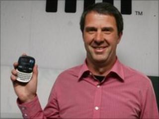 Robbie Bach holding a Microsoft Kin