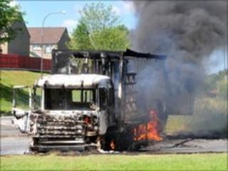 The vehicles were burned as police carried out searches in the area