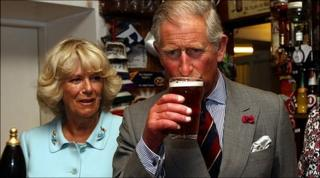 Prince Charles samples a pint of local real ale at the bar of the Neuadd Arms Hotel, Llanwrtyd Wells