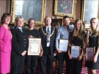 Lucinda Wannop, Jack Ferguson and Clare Lyden and Robin Smethurst receiving their awards with the mayor and Lancashire Police