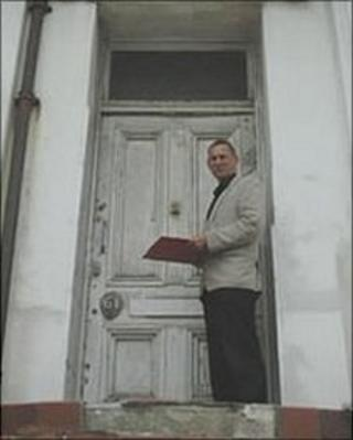 Councillor Jeremy Birch on the steps of a property in Hastings