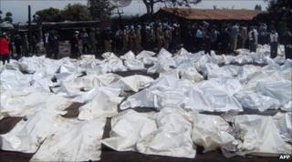 Sheets cover the bodies of those who died in the accident in Sange
