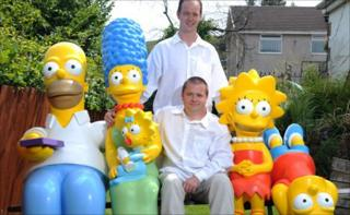 Glyn Stott, partner Roy Culliford and the Simpsons' replicas