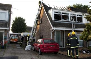 Firefighters tackle the fire at Eastcot Close in Holbury