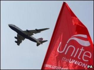 British Airways plane takes off over a union picket line