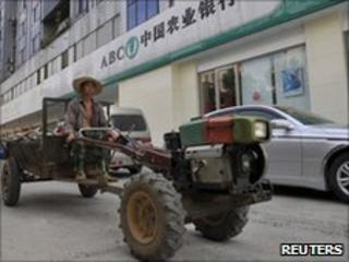 Agbank tractor and car