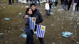 Fans in Montevideo react after the Uruguay-Holland match