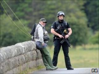 Police officer with fisherman in Rothbury