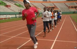 South African runner Caster Semenya leads young Ivorian athletes in training drills at a stadium in Abidjan, Ivory Coast Thursday, May 27, 2010