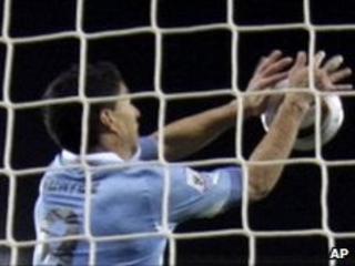 Luis Suarez handling the ball