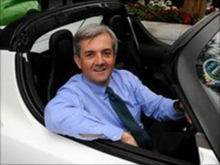 Chris Huhne in eco-friendly car