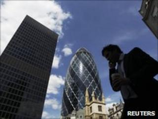 Man passing City of London landmarks