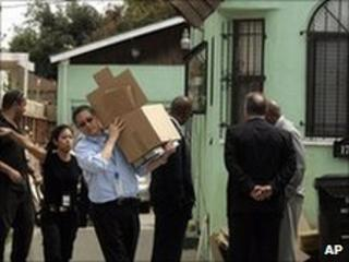 Officials remove items from the home of Lonnie Franklin in Los Angeles. Photo: 7 July 2010