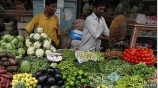 A vendor sells vegetables at a market in Mumbai June 14, 2010
