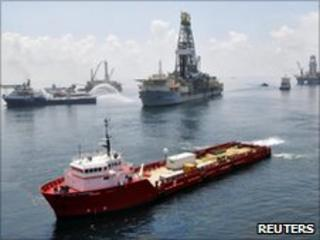 Ships and drilling rigs surround the Discoverer Enterprise