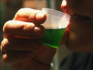 Man drinking methadone