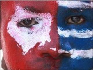 West Papuan protester's face, painted as the banned separatist flag, 8 July 2010