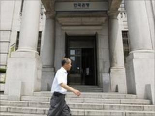A man walks past the Bank of Korea