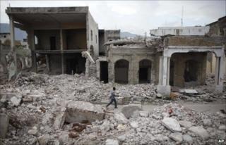 Man walks through rubble in Port au Prince