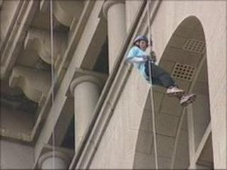 Abseiler on Liver building
