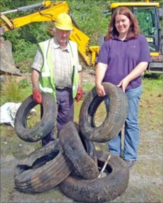 Ceredigion council tidy towns officer, Rachel Mills at Llanilar Yard with staff from Mike Oliver Metals
