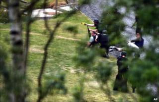 Police training weapons, including a Taser gun, on Raoul Moat during a stand-off