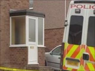 Police remain at the scene of the house