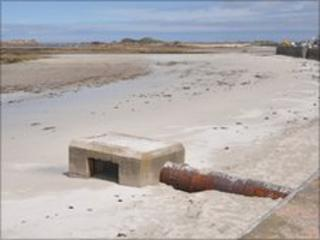 Water outfall on the beach at Cobo