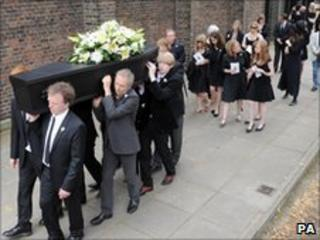 Dame Beryl Bainbridge's coffin carried at funeral