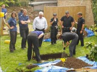 Police officers and archaeologists excavate Tobin's former home in Portslade