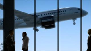Cseries flies past airport, Bombardier image