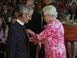 Reverend Andrew Jolly receiving MBE from the Queen