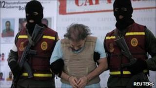 """Colombian Carlos Alberto """"Beto"""" Renteria is escorted handcuffed by Venezuelan secret police"""