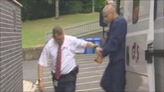 Krystian Krysztof Rozek arriving at Mold Magistrates' Court