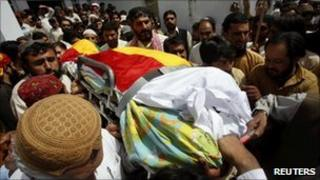 Supporters carry the body of Habib Jalib in Quetta on July 14, 2010