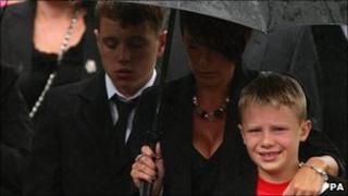 Ethan Horton, 9, follows the coffin of his father Colour Sergeant Martyn Horton
