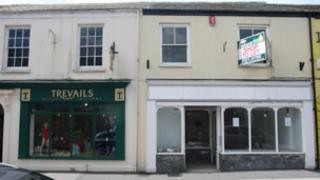 School outfitter Trevails and vacant shop