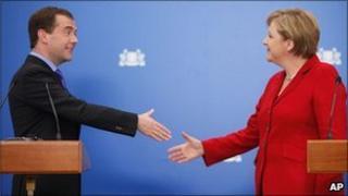 Russian President Dmitry Medvedev and German Chancellor Angela Merkel