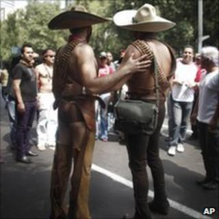 Gay couple during the gay pride parade in Mexico City, 26 June 2010