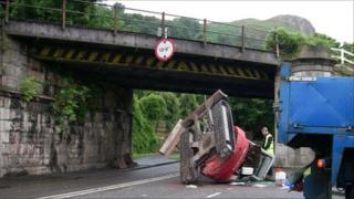 The mini-digger was pictured in the road at around 0830 BST on Friday