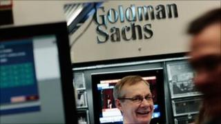 Financial professional stands in the Goldman Sachs booth at the New York Stock Exchange